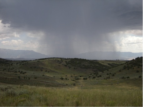 Watching storm clouds roll in during a chukar hunt.