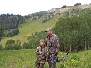 Author Scott Root and his son archery hunting in Utah.